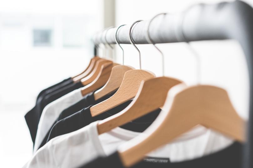 wooden-t-shirt-hangers-in-fashion-apparel-store-picjumbo-com
